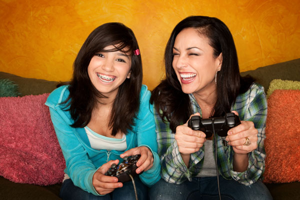 hispanic-woman-and-teenage-daughter-playing-video-game